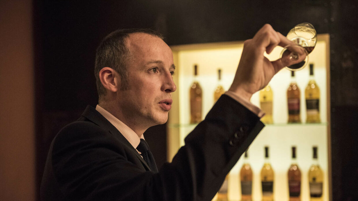 photo of Brendan McCarron of Glenmorangie looking at a glass of whisky