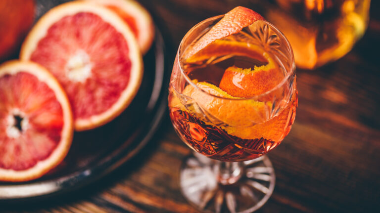 Oranges and other citrus in a glass with whiskey