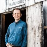 Conor O'Driscoll, master distiller at Heaven Hill, poses outside a barrel warehouse.