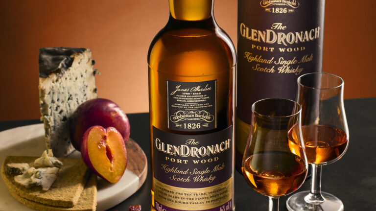 artistic image of GlenDronach Port wood bottle with cheese and glasses filled with whisky