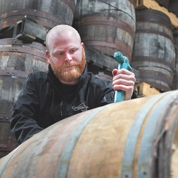 isle of raasay head distiller iain robertson pulls whisky from a cask