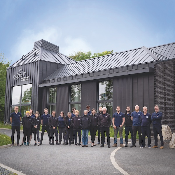 large group of staff in front of Isle of Raasay Distillery