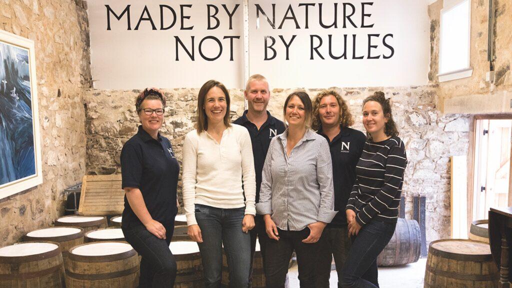 distilling staff of nc'nean scotch whisky distillery