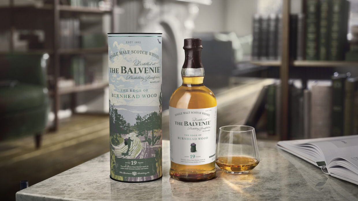 bottle of balvenie 19 year old the edge of burnhead wood and glass of scotch whisky