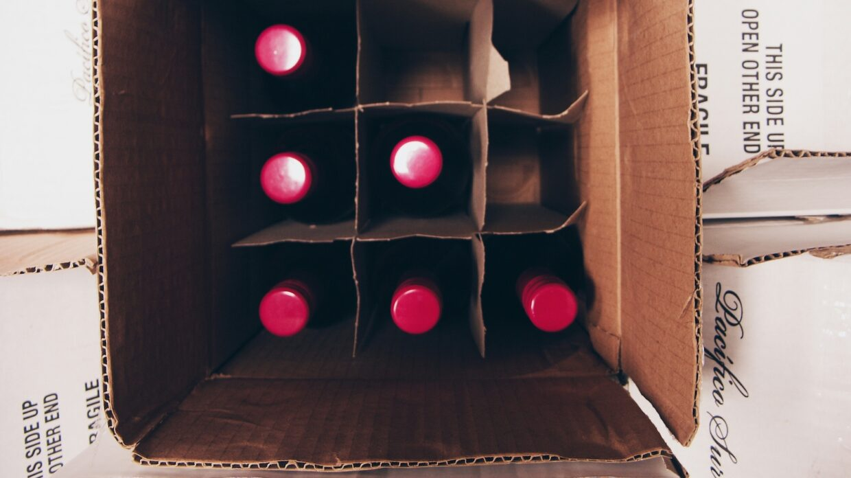 aerial view of whiskey or wine bottles in a box ready for shipping