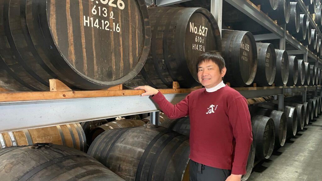 ohishi whisky master distiller kazunori oishi in his barrel warehouse