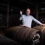 teeling whiskey distillery master distiller alex chasko takes a bung from a single pot still whiskey barrel