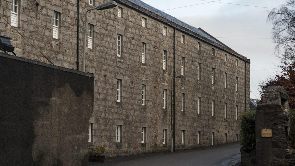 The exterior of the malt house at Glen Garioch Distillery in Scotland