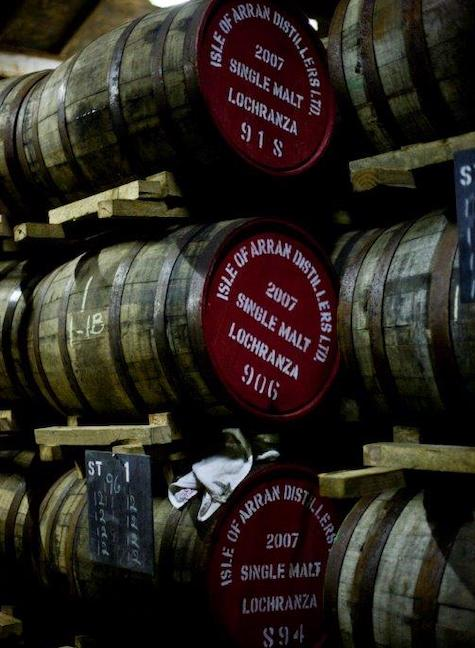 casks of single malt scotch stacked three high at isle of arran distillery