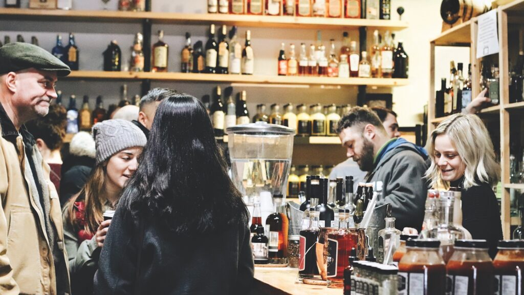 People gather in a crowded liquor store.