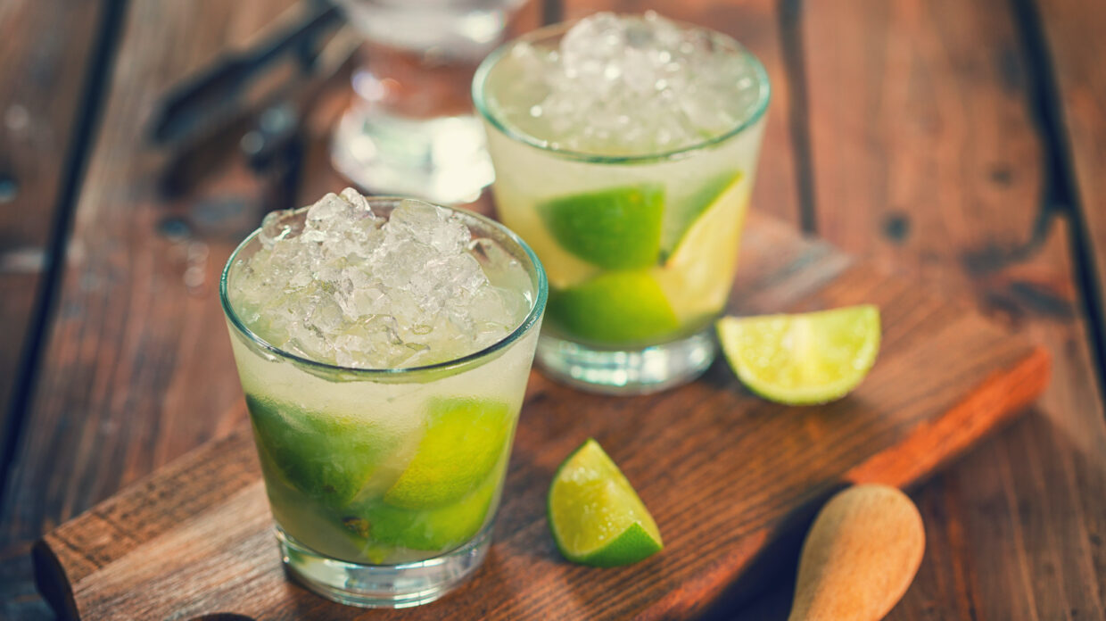 Sweet and refreshing Caipirinha national cocktail from Brazil made with lime, ice, sugar, and cachaça
