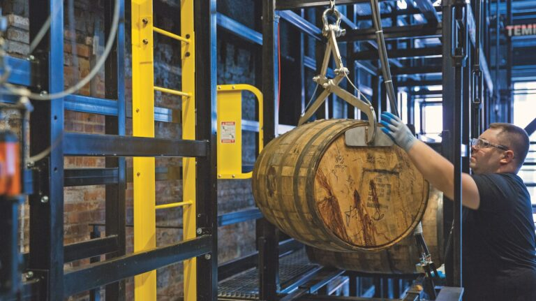 man handles barrel hanging from ceiling
