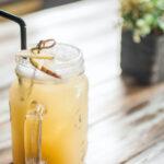 yellow cocktail in mason jar