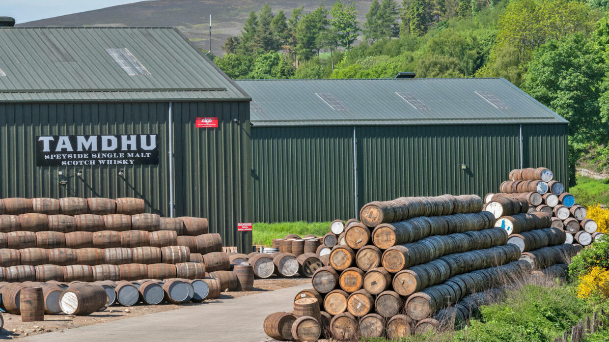 exterior shot of tamdhu distillery with barrels out front
