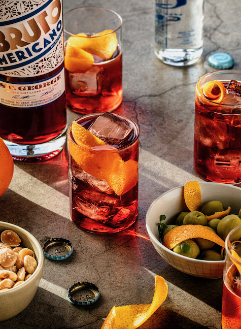 Bruto Americano spritz cocktails with olives and nuts