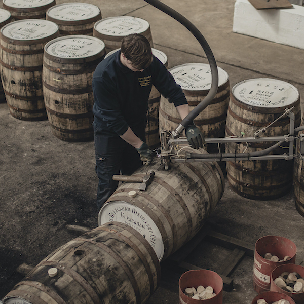 a worker fills casks with glencadam whisky