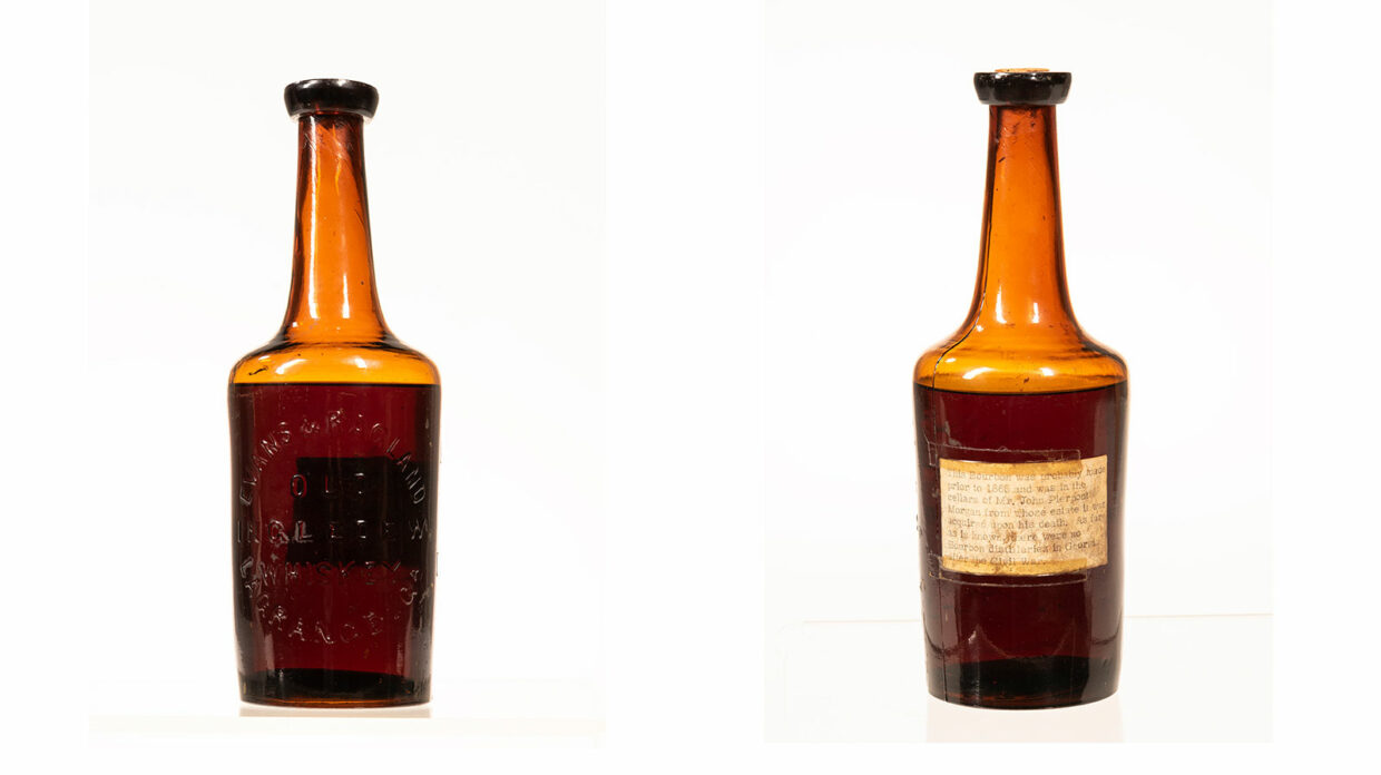 The front and back of an old bottle of whiskey