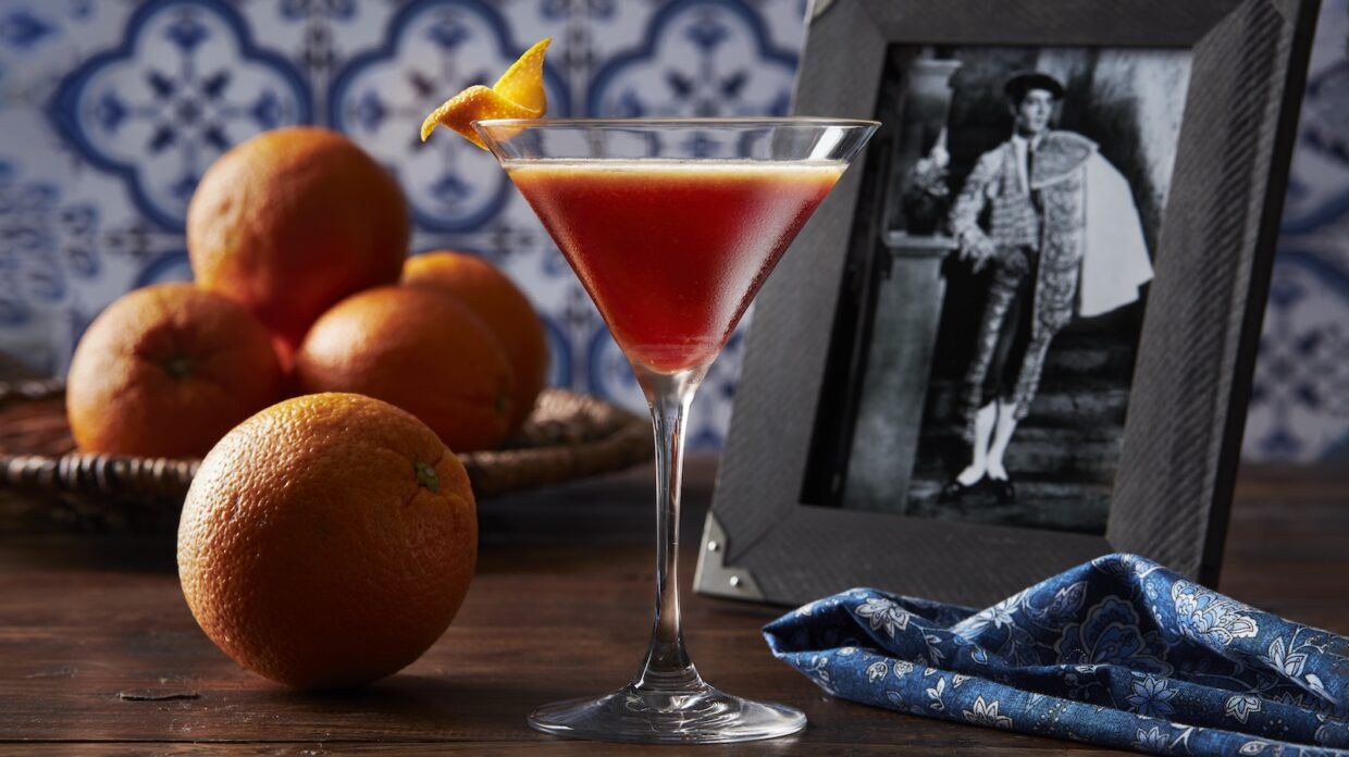 Blood and Sand cocktail on the table with some oranges