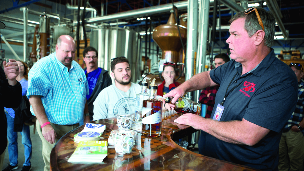 Visitors crowd around Mother Earth Spirits' taproom bar