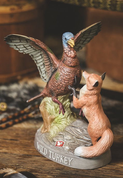 A decanter of a turkey and a fox