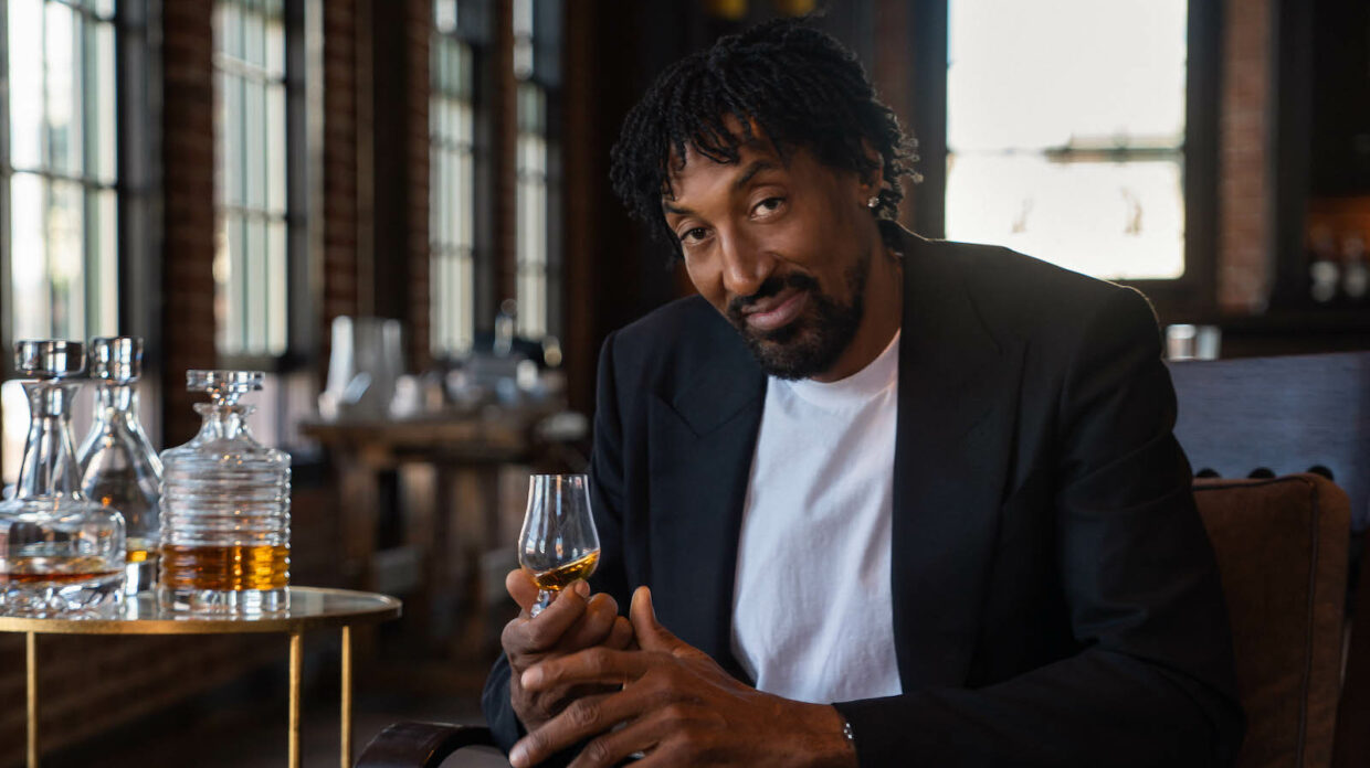 Scottie Pippen holds a glass of whiskey