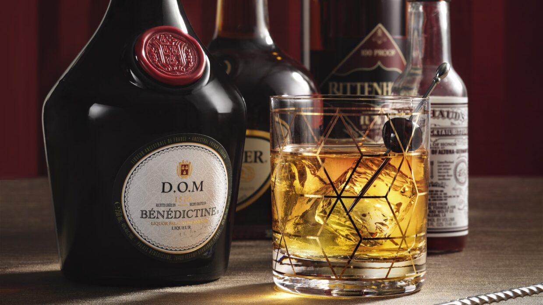 Whisky glass and liquor bottles