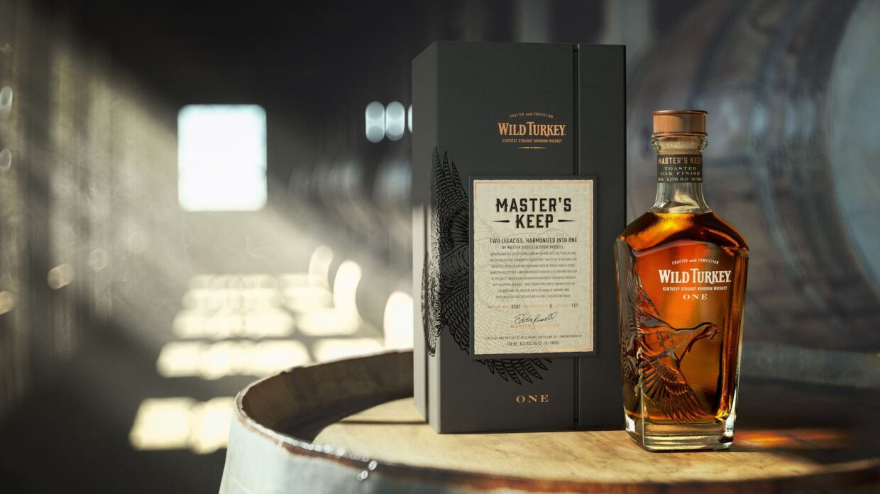 Bottle of whiskey and display box on a barrel
