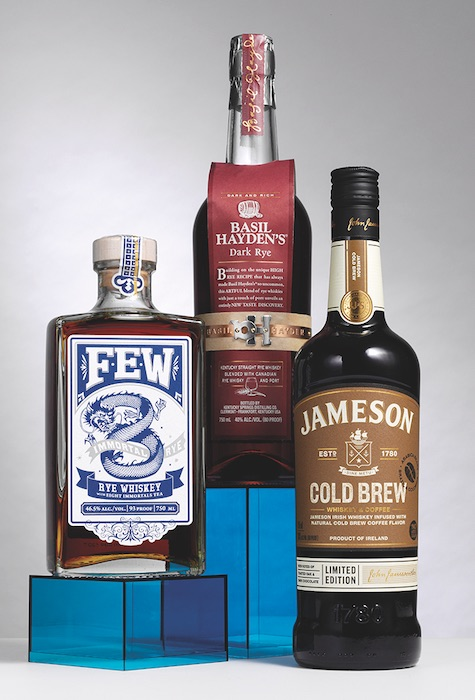 Three bottles of flavored whisky